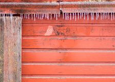 Winter scene of an old red barn. Royalty Free Stock Photography