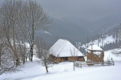 Winter scene with old wood house Stock Image