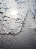 Winter Scene  Painted by Jack Frost. A winter scene painted on a window by the mythical character Jack Frost Royalty Free Stock Photo