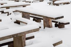 Winter scene with park bench and snow Stock Photos