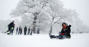 Winter scene. From the park in East Barnet, London with people enjoying in snow
