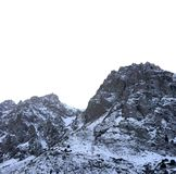 Rocky mountains of Zaili Alatau covered by snow. Winter scene of peaks in Kazakhstan Royalty Free Stock Image