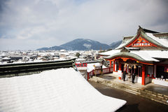 Winter scene of people praying in a japanese templ Royalty Free Stock Photos
