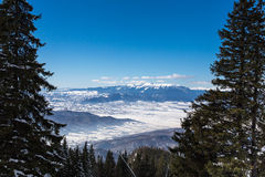 Winter scene in Poiana Brasov. Winter scene of the Carpathian mountains as seen from Poiana Brasov, Romania Stock Photos