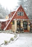 Quaint cottage during the snow. Winter scene of a quaint cottage in the forest during the snow Royalty Free Stock Photos