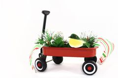 Winter Scene In Red Wagon Stock Photos