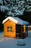 Winter scene of a snow covered playhouse Stock Image