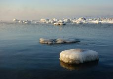 Winter scene with snow covered rocks by the Baltic sea in Helsinki, Finland Royalty Free Stock Images