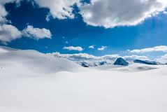 Winter scene, beautiful minimal snowy mountains. Winter scene, snowy mountains, subtile landscape of alpine glacier during sunny day Royalty Free Stock Photography