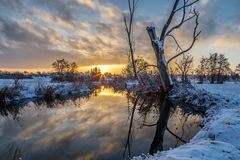 Winter scene: sunrise at the river
