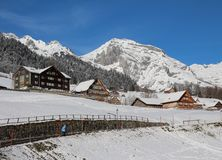 Winter scene in the Toggenburg valley, mountain and traditional architecture Royalty Free Stock Photo