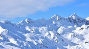 Winter Snowy Landscape Mountain Range. Winter scene on Vogel, Slovenia. Snowy landscape high in the mountains. Panoramic photo of mountain range in the Vogel, a royalty free stock photography