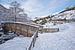 Winter scene of Wooden bridge in Gourette mountain village Royalty Free Stock Photography