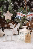 Winter scene with wooden reindeer and lantern for christmas Stock Image