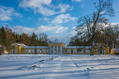 Winter scene of yellow building of Ferdinand colonnade in Marienbad. Winter scene of yellow building of Ferdinand colonnade with mineral water at spa town stock photo