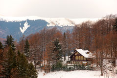 Winter scenery. A remote, snow covered cottage in the heart of the Carpathian mountains Royalty Free Stock Image