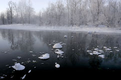 Winter scenery. A non-frozen rivers in winter scenery Stock Photos