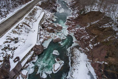 Winter scenery. Aerial view of the road and turquoise river. Stock Images