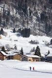 Winter scenery in the Alps, skiers runing, Austrian Royalty Free Stock Photos