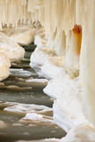 Winter scenery. Baltic Sea. Close up ice formations icicles on pier poles Stock Images