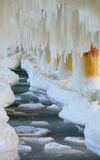 Winter scenery. Baltic Sea. Close up ice formations icicles on pier poles Stock Image