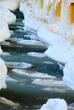 Winter scenery. Baltic Sea. Close up ice formations icicles on pier poles Royalty Free Stock Images