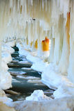 Winter scenery. Baltic Sea. Close up ice formations icicles on pier poles Royalty Free Stock Photography