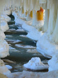 Winter scenery. Baltic Sea. Close up ice formations icicles on pier poles Royalty Free Stock Photo