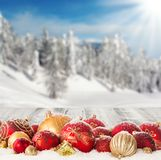 Winter scenery with christmas balls Royalty Free Stock Photo