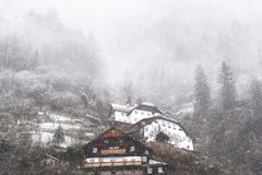 Snowfall over austrian  mountain village Royalty Free Stock Photography