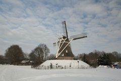 Dutch windmill in the Wintertime stock images