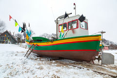 Winter scenery of fishing boats at Baltic Sea Royalty Free Stock Photos