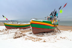 Winter scenery of fishing boats at Baltic Sea Royalty Free Stock Image