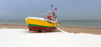 Winter scenery of fishing boats at Baltic Sea Royalty Free Stock Photography