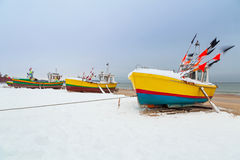 Winter scenery of fishing boats at Baltic Sea Stock Photo