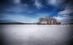 Winter scenery of frozen lake in city park Stock Photo