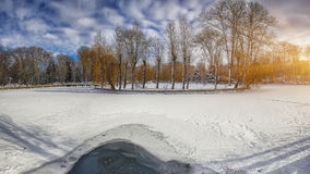 Winter scenery of frozen lake in city park. Stock Photos