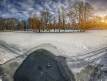 Winter scenery of frozen lake in city park. Royalty Free Stock Photography