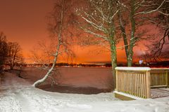Winter scenery with frozen lake at night stock photo
