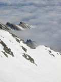 Winter scenery during inversion. High Tatra, dramatic shot over the cloud formed by a temperature inversion Royalty Free Stock Photo