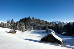 Winter scenery with log cabin Royalty Free Stock Images