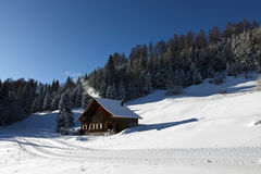Winter scenery with log cabin Royalty Free Stock Photography