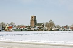 Winter scenery in the Netherlands. Snowy little village in the countryside from the Netherlands Royalty Free Stock Photo