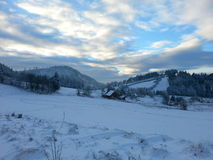 Winter scenery. Panoramic view at mountains during a sunset Stock Photos