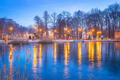 Winter scenery of the park in Trzebnica. With frozen pond, Poland Royalty Free Stock Image