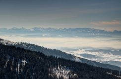 Sunlit blue Tatra ridges forests of Babia hora and hazy valleys stock images