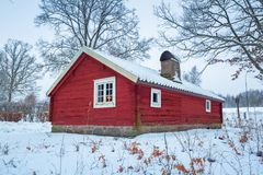 Winter scenery with red wooden house. In Sweden Stock Images