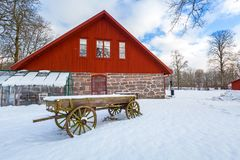 Winter scenery with red wooden house. In Sweden Stock Image