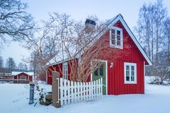 Winter scenery with red wooden house. In Sweden Stock Photo