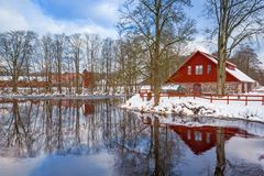Winter scenery with red wooden house. In Sweden Stock Photos